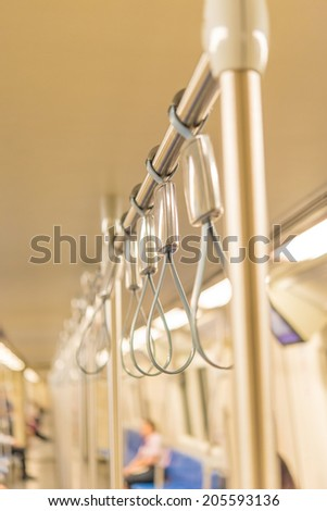 Handles for standing passenger inside a train - stock photo