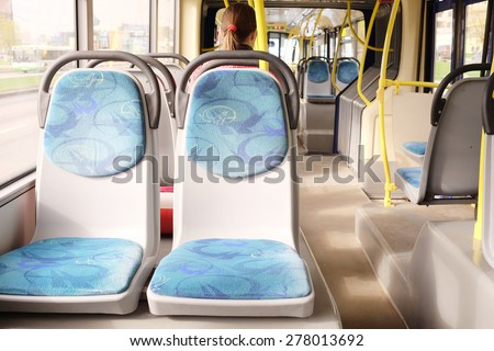 Handles for standing passengers inside a bus - stock photo