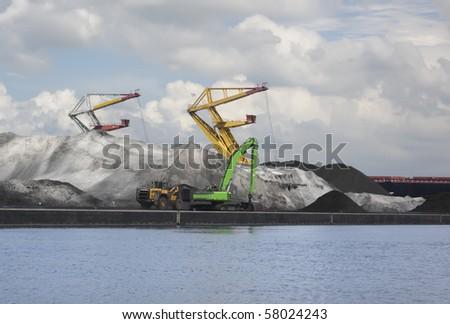 Handling of bulk cargo in port - stock photo