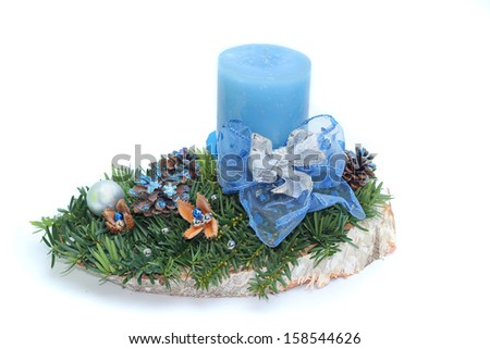 handmade advent spray with blue candle and ribbon, isolated on white - stock photo
