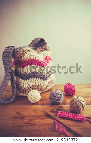 Handmade bag with balls of wool,old retro vintage style - stock photo