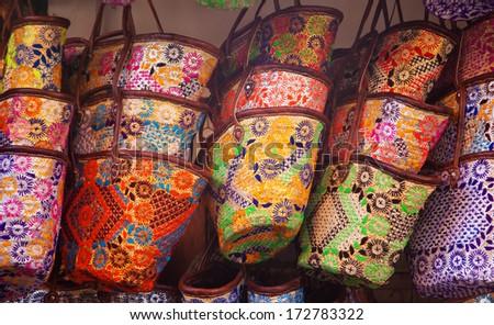 handmade bags on the open market in Marrakesh ,Marocco  - stock photo