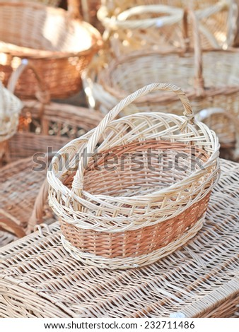 Handmade baskets for sale at a souvenir market in Romania. Traditional Romanian handmade wood baskets - stock photo
