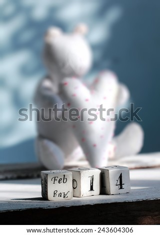 "Handmade bear and white heart with   "" feb. 14 ""  words  , Valentine`s day Wallpaper."