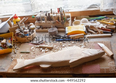 handmade carved wooden fish in the workshop. the unfinished carpentry work. fish carved from wood - stock photo