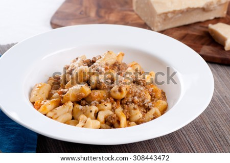 handmade cavatelli pasta with a rich meat tomato sauce - stock photo