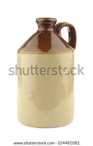 handmade ceramic jug on a white background - stock photo