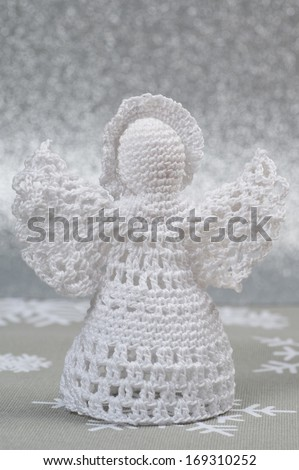 Handmade Christmas Crochet Angel on silver background - stock photo