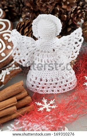 Handmade Christmas Crochet Angel with a halo - stock photo