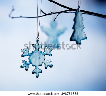 Handmade christmas decoration made from blue glass - stock photo