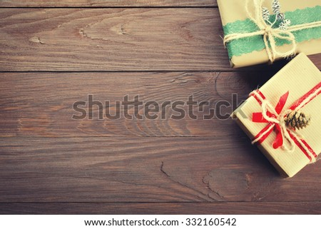 Handmade christmas gift boxes on wooden table with copy space - stock photo