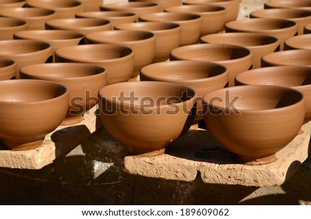 Handmade clay dishware from a pottery factory - stock photo