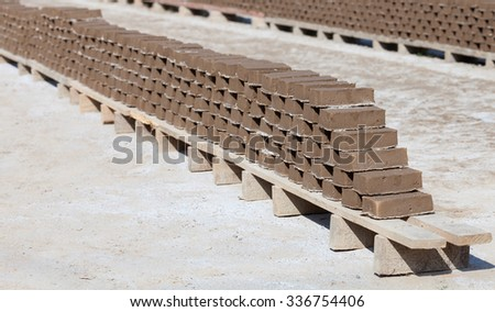 Handmade clay house bricks drying in the sun