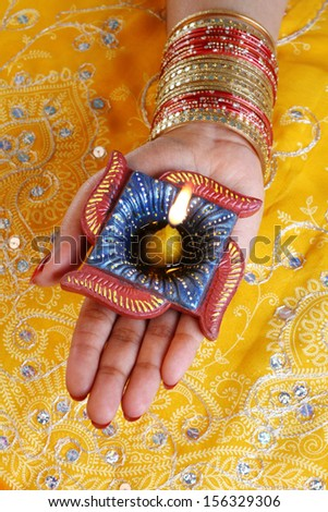 Handmade Diwali Diya Lamp in Hand - stock photo