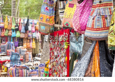 handmade earrings and shoulder bags at the weekend market in Anjuna,Goa. - stock photo