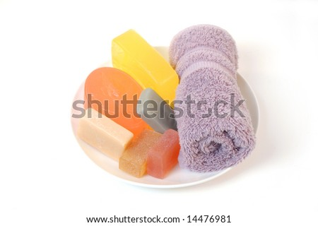 handmade face soap and towel - stock photo
