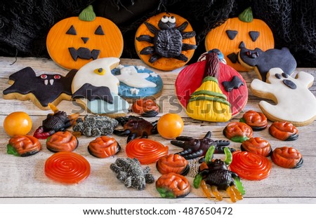Handmade halloween cookies on wooden background