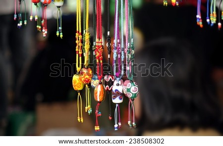 Handmade jewelry, necklaces and bracelets with colorful glass beads - stock photo