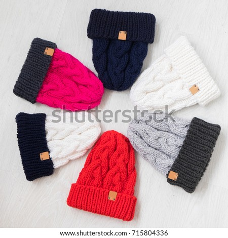 handmade knit hats on white background