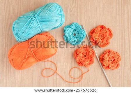 Handmade knitted crochet flowers. Top view - stock photo