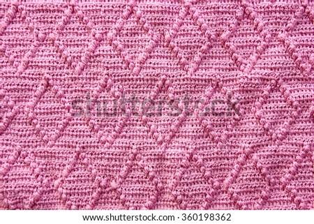 Handmade knitting lozenge pattern background. - stock photo
