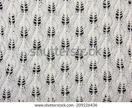 handmade knitwear with artful pattern - stock photo