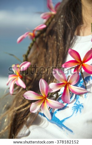 Handmade lei of frangipani, which were subjected to the neck-1 - stock photo