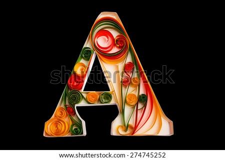 Handmade letter from flower quilling alphabet. isolated on black including clipping path - stock photo