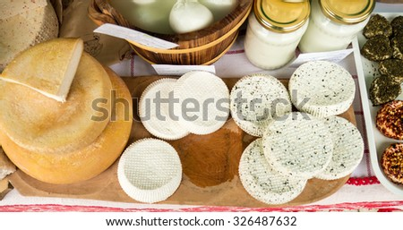 Handmade local cheese assortment, on a fair of traditional products, in Miercurea-Ciuc, Harghita, Romania. Shallow depth of field. - stock photo