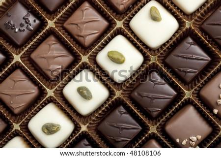 Handmade luxury chocolate in a box - shot in studio - stock photo