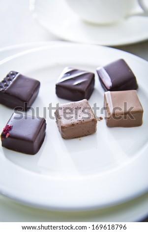 Handmade luxury chocolate on white plate - stock photo