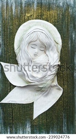 Handmade painting from leather at the fair. - stock photo