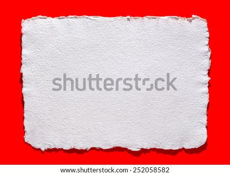 handmade paper on red background, isolated, for Valentine's day message - stock photo
