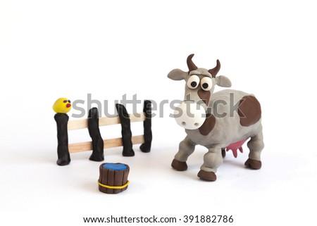 Handmade plasticine cow - stock photo