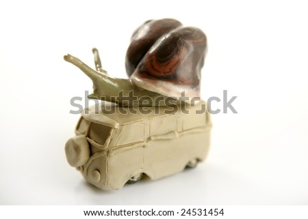 Handmade plasticine van with snail over, isolated on white - stock photo
