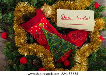 Handmade red stocking at the green christmas tree background - stock photo