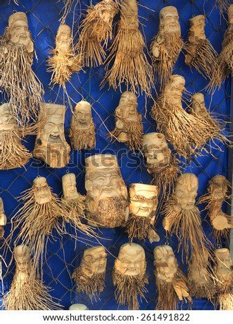 handmade shop in Vietnam,Human faces made of roots        - stock photo