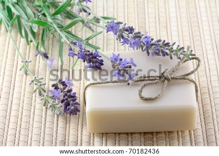 handmade soap and lavender on bamboo background - stock photo