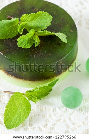 Handmade soap and mint leaves and a white background