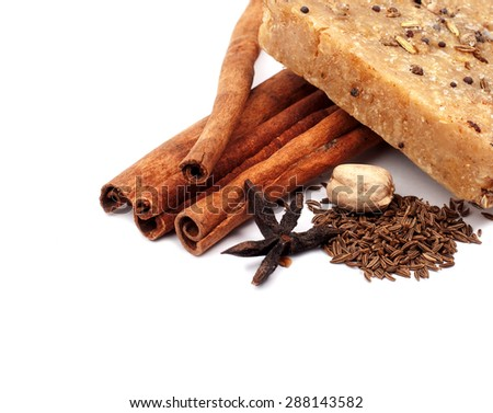 handmade soap with cinnamon and anise star on white background