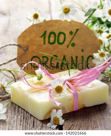 handmade soap with flowers on the organic background - stock photo