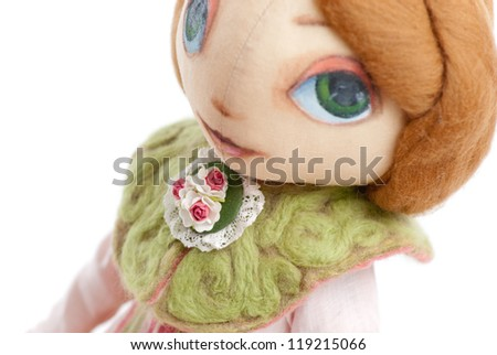 handmade toy cute litlle girl with big eyes isolated - stock photo