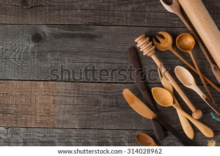 handmade various wooden kitchen utensils on vintage table background - stock photo
