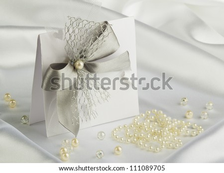 handmade wedding card on a white satin fabric