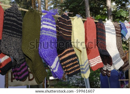 Handmade wool socks hanging on a clothesline - stock photo