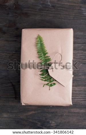 Handmade wrapped christmas present - stock photo