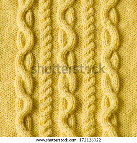 Handmade yellow knitting wool texture background - stock photo