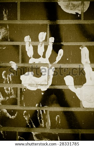 handprint on brick - stock photo