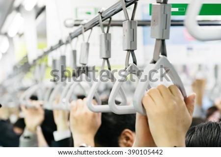 Handrail of the Japanese train during rush hour - stock photo