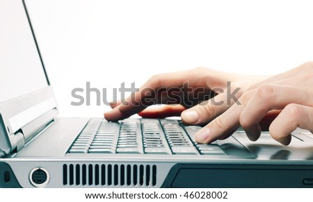 Hands above computer keyboard